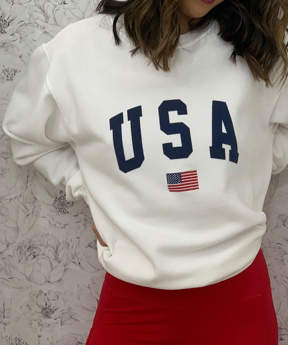 Peonies & Anemones White Floral Wallpaper • Girl in USA jumper in front of White Floral Wallpaper