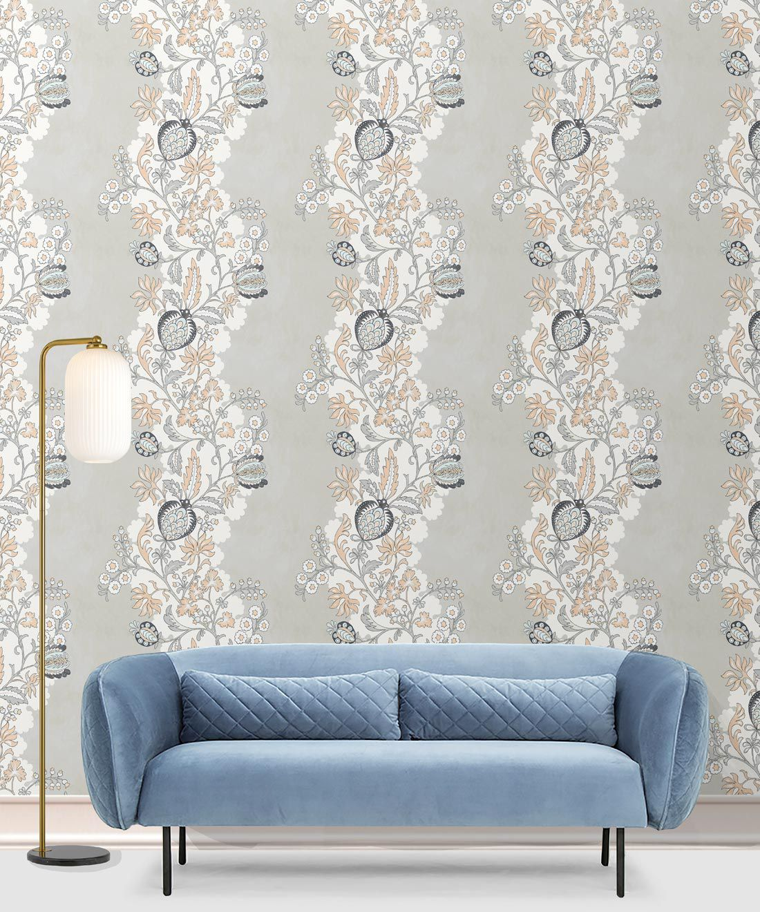 Pomegranate Wallpaper • salmon • insitu with a blue sofa