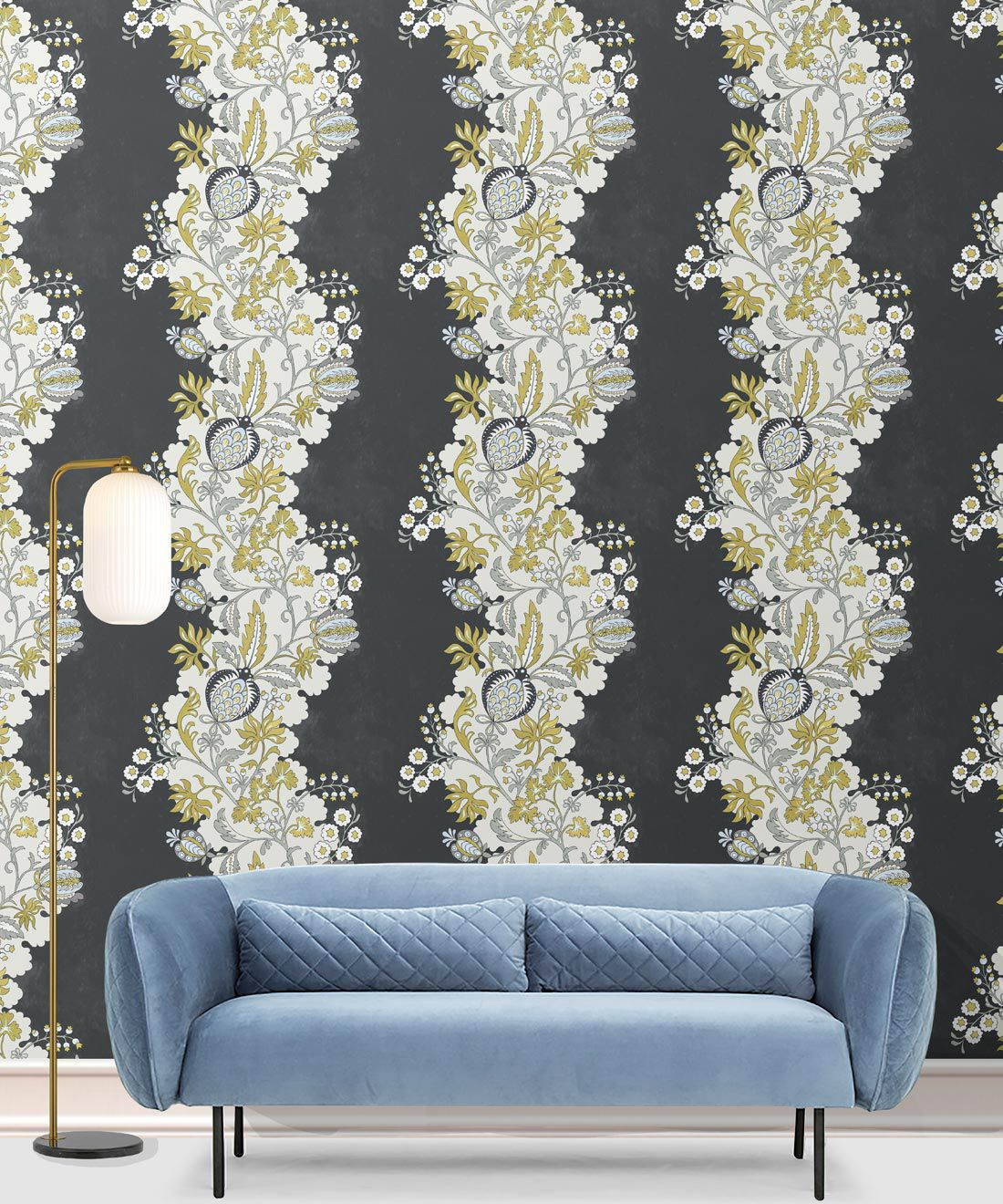 Pomegranate Wallpaper • Charcoal • Insitu with blue sofa