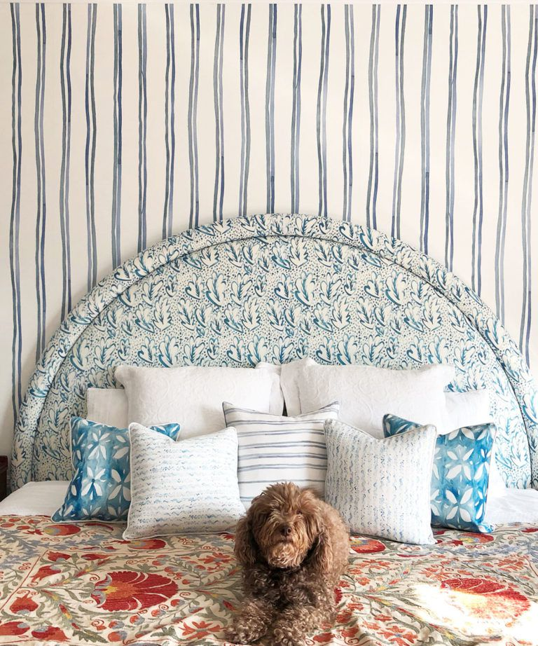 Double Inky Stripe • Striped Wallpaper • Blue Striped Wallpaper Rolls • Georgia MacMillan • Milton & King UK • Bedroom wallpaper showing a bed with a brown dog