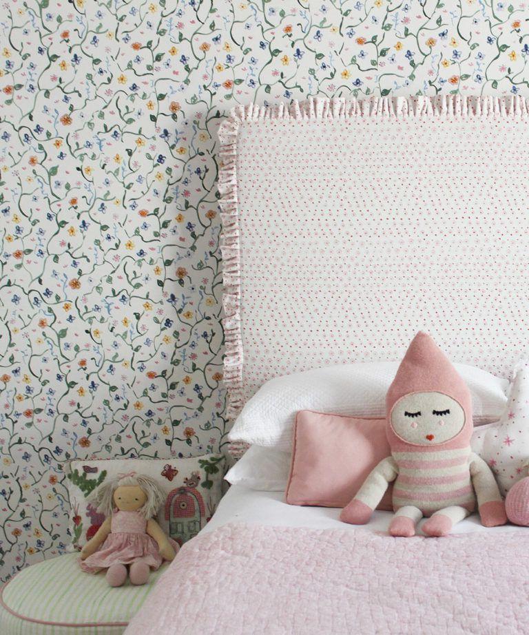 Wild Garden • Dainty Floral Wallpaper • Milton & King UK •Georgia MacMillan • Childrens Wallpaper • Nursery Wallpaper • Bed with pink headboard and pink duvet