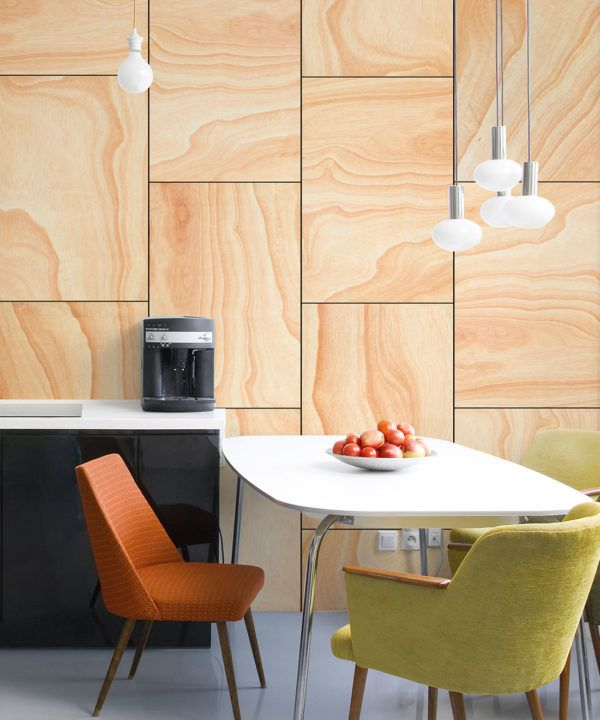 Ply Wood Wallpaper • Light Brown Wallpaper •Wood Grain Wallpaper insitu with an orange chair and a green chair around a white table