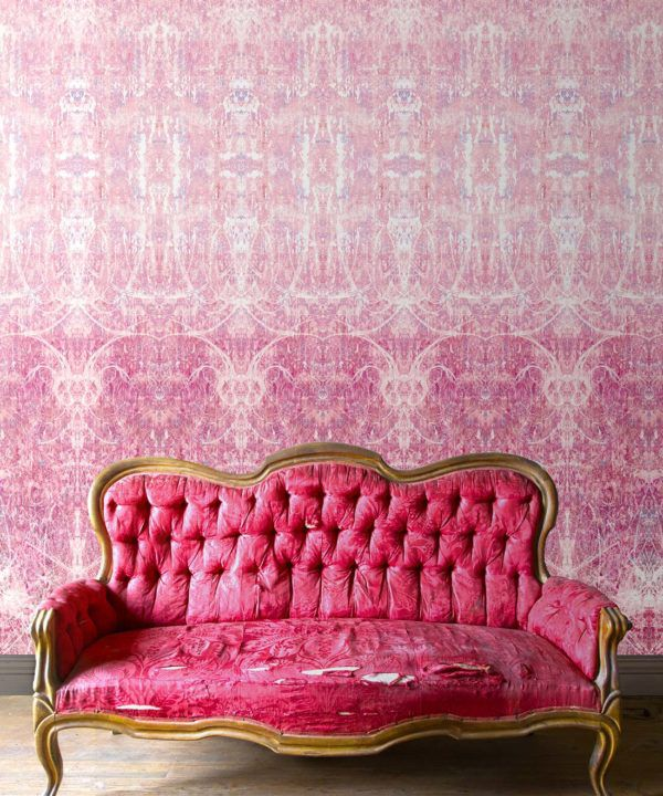 Hori Wallpaper by Simcox • Color Rose • Abstract Wallpaper • insitu with a pink sofa