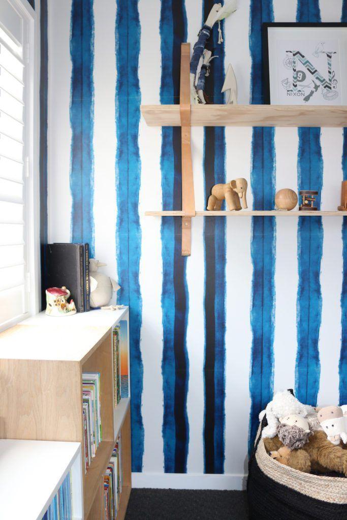 Boys bedroom with Shibori Stripe Wallpaper hung vertically shelving