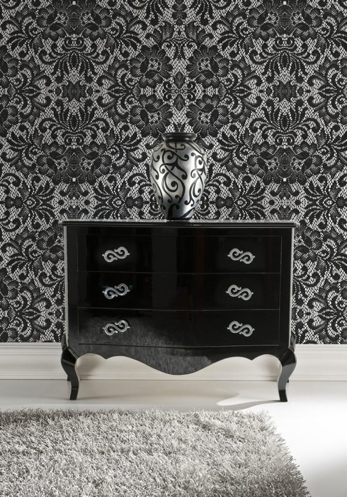 Huntington Lace Wallpaper.  White floors and black lace wallpaper with a short black dresser