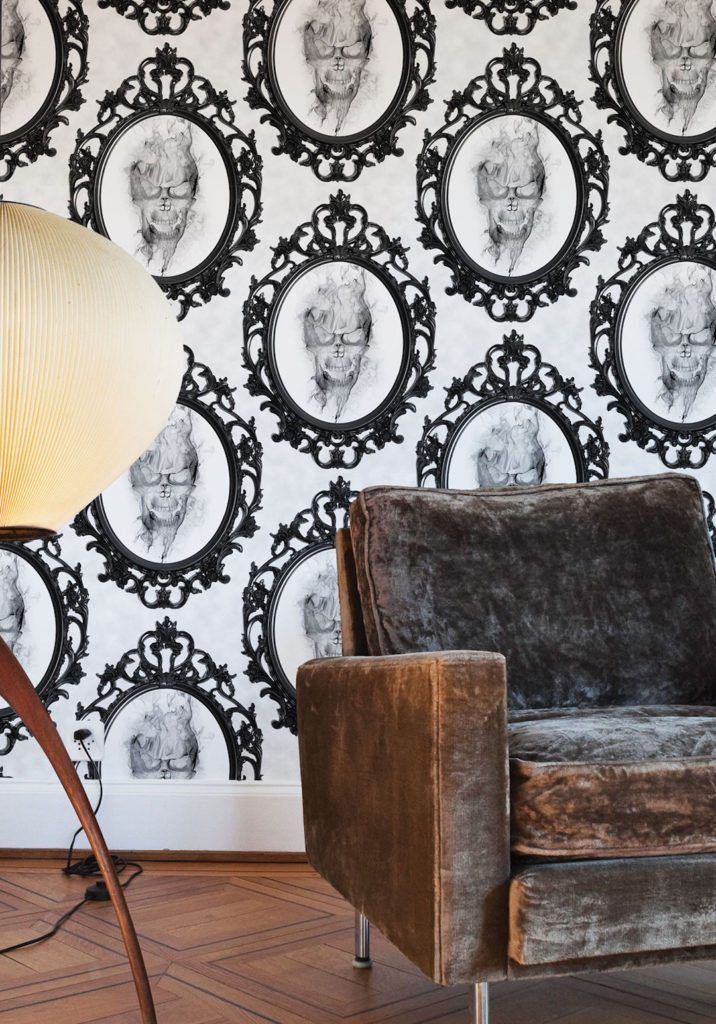 Amityville Wallpaper. white Skull wallpaper with a smokey skull in a mirror with a brown chair