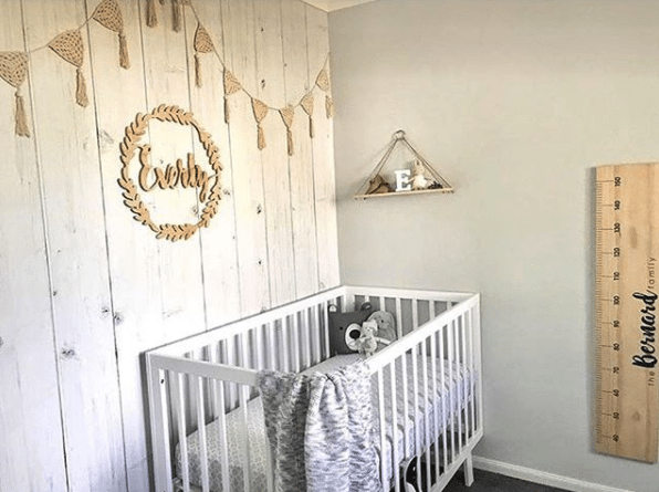 nursery with whitewashed timber wallpaper, the best seller for 2017, hung vertically with white crib wooden decorative wall art and a large ruler for measuring growing kids