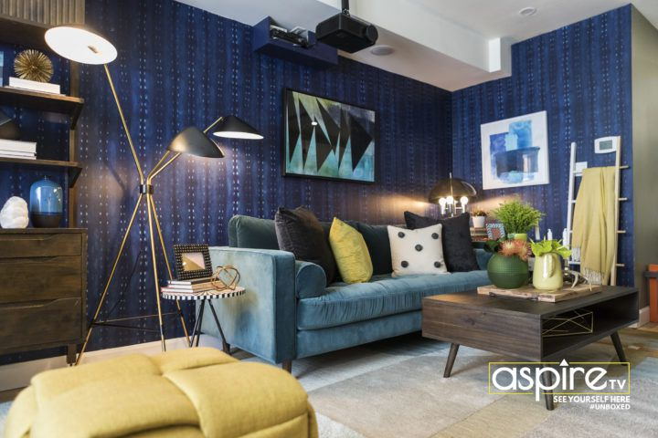 Dark Blue City Scape wallpaper from Milton & King on the wall with a teal sofa and brown coffee table