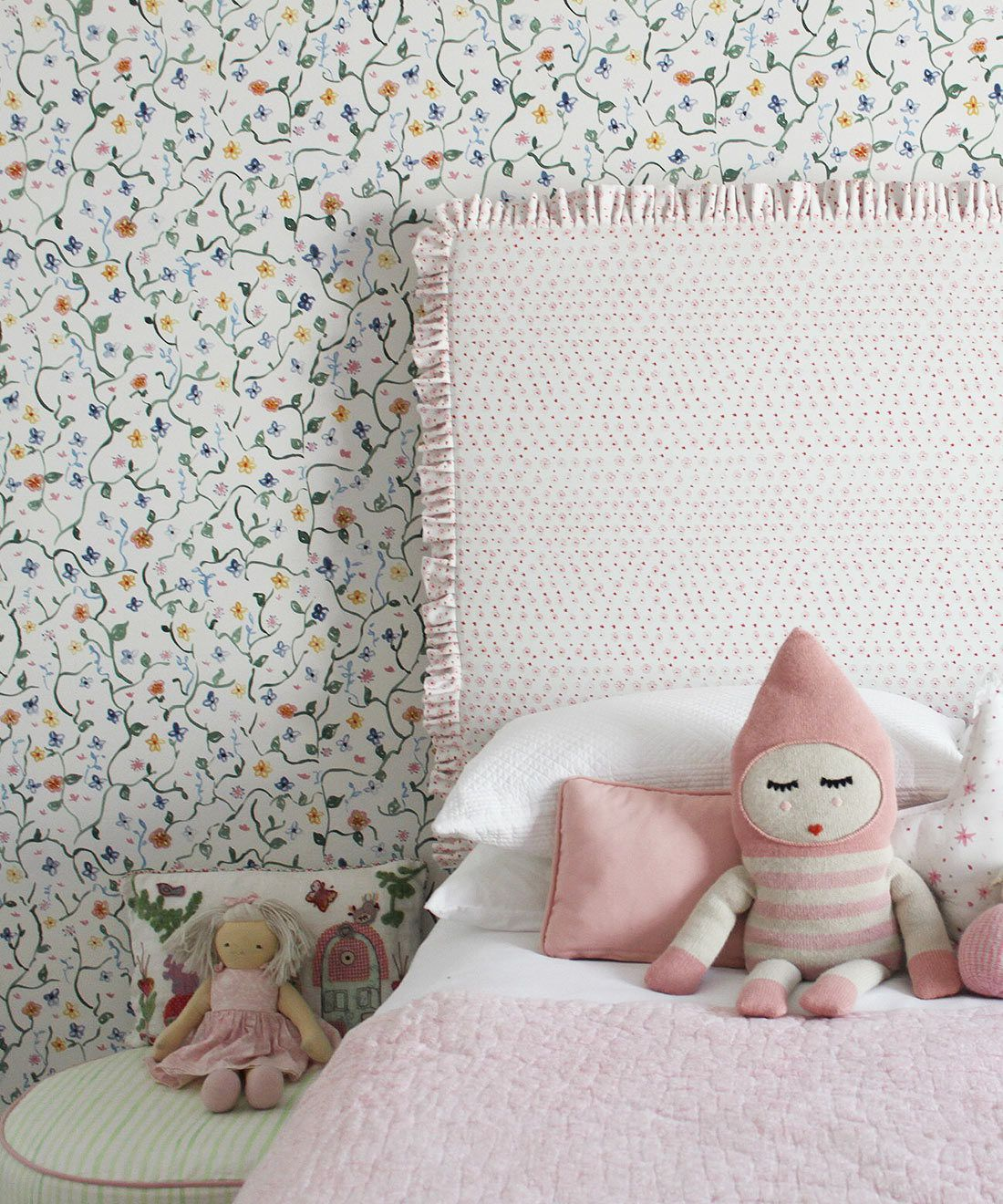 Wild Garden • Dainty Floral Wallpaper • Milton & King USA • Georgia MacMillan • Childrens Wallpaper • Nursery Wallpaper • Bed with pink headboard and pink duvet