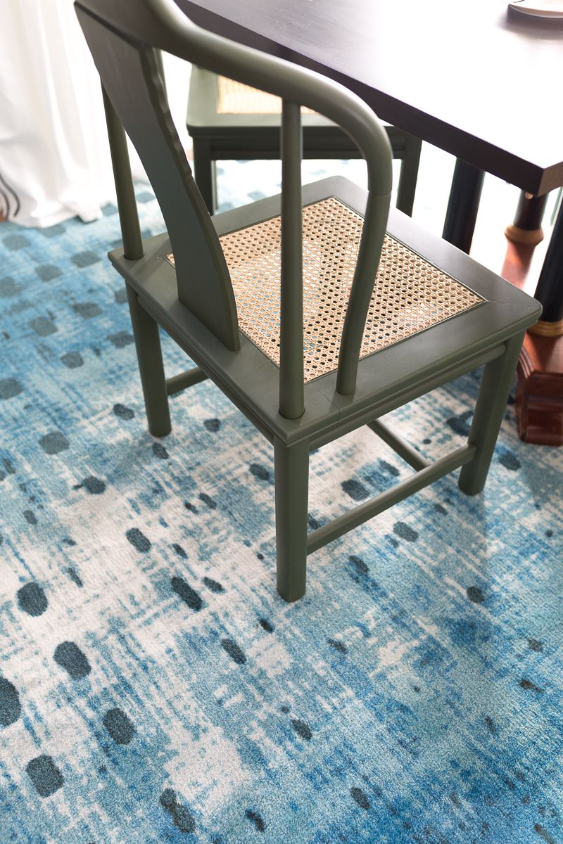 Jewel Marlowe Basement Makeover • Looking down on a green chair with sitting on a blue carpet