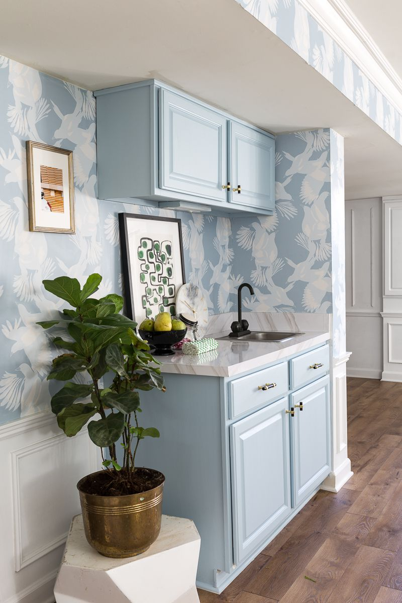 Jewel Marlowe Basement Makeover •Kitchen Cabinets have been painted a light blue to match the light blue magpie wallpaper