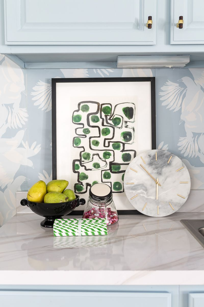 Jewel Marlow Basement Makeover • A kitchen counter top with a black bowl of green pears