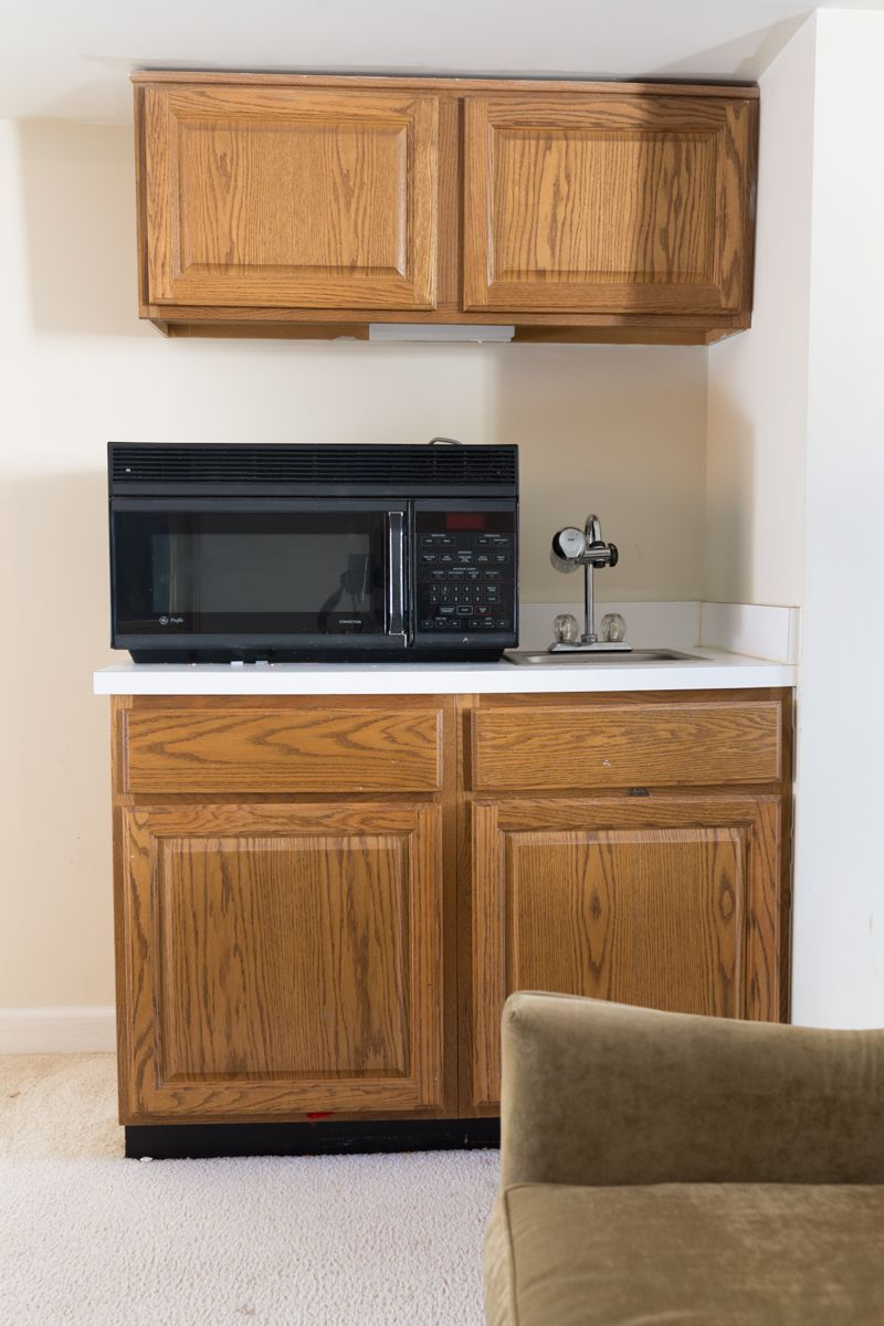 Jewel Marlowe Basement Makeover • a sink area with a microwave on top of the counter