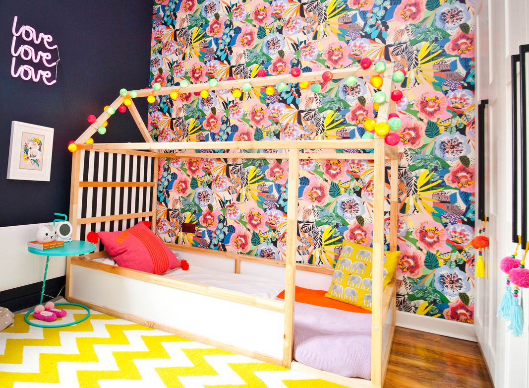 Lissi Walker • Girls Bedroom Makeover •Summer Garden Wallpaper • Kitty McCall • The left wall is darkly painted with a neon sign that says the word