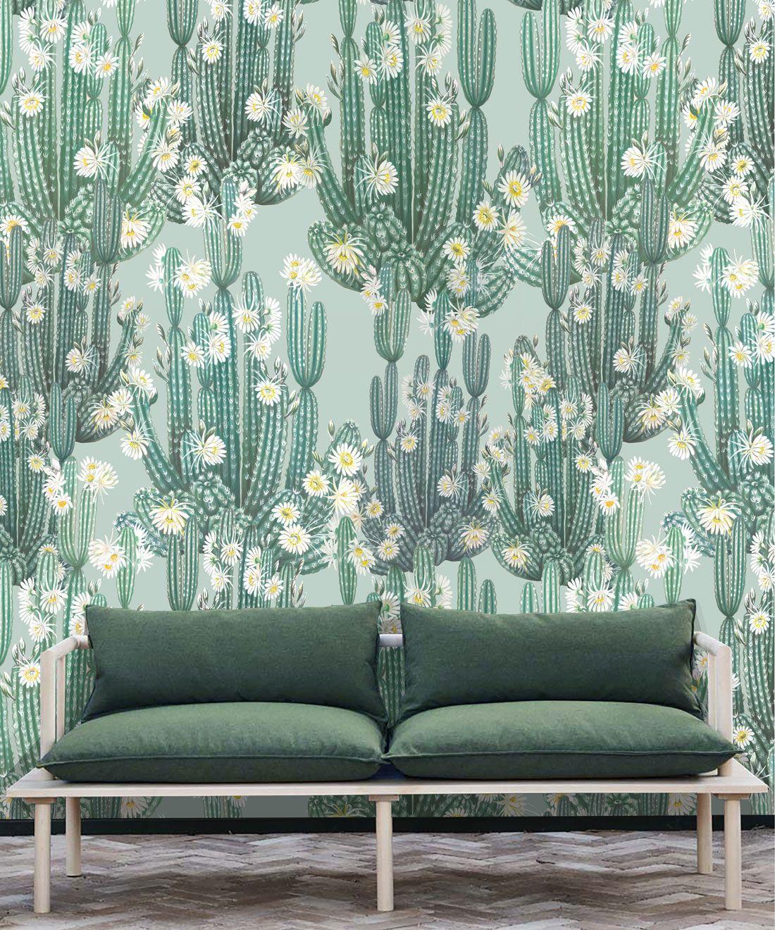 San Pedro Wallpaper Aqua • Cactus Wallpaper • Succulents Wallpaper • Desert Wallpaper Insitu behind sofa with green cushions