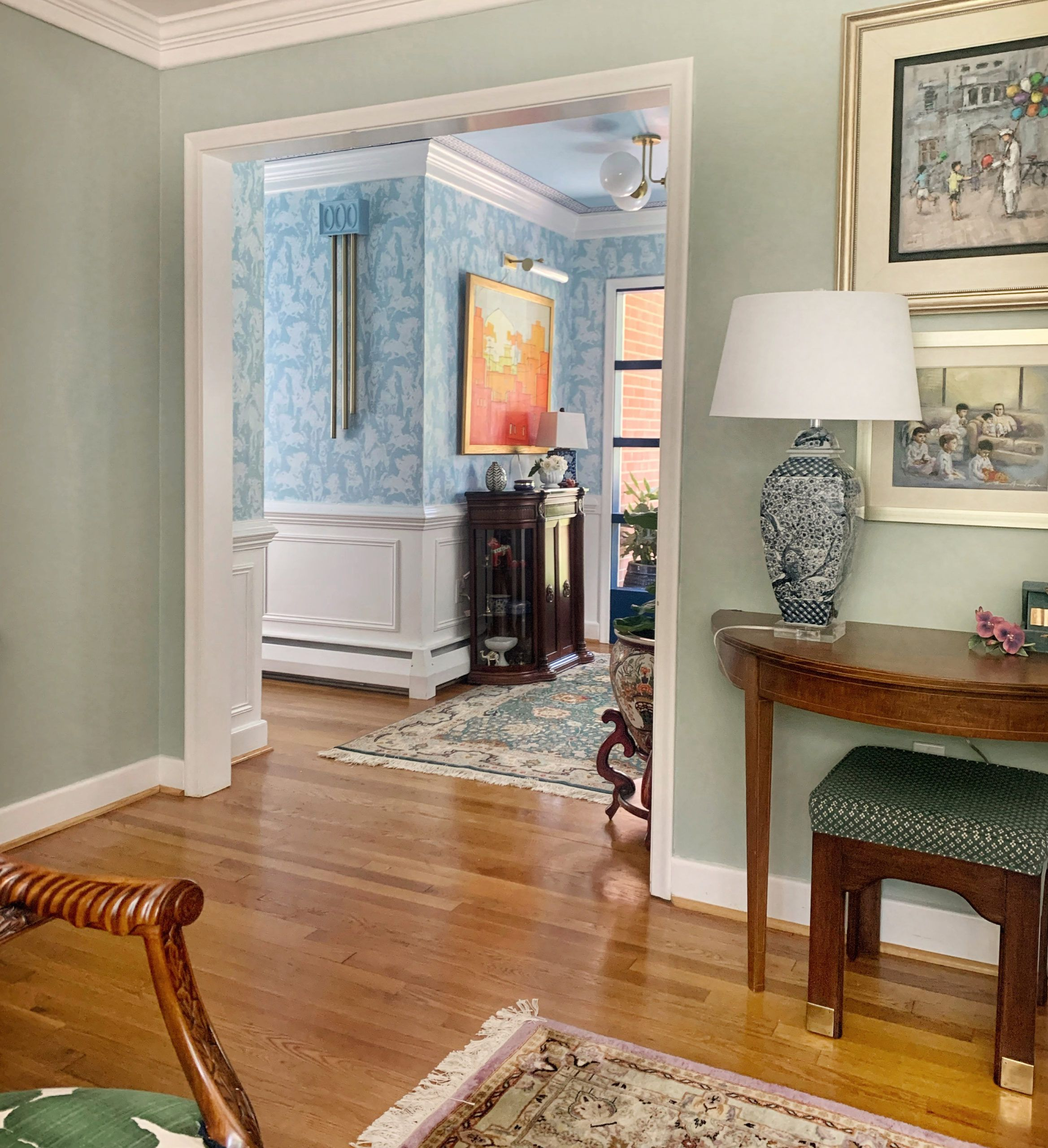 Image of the Entry way makeover by Merh Niazi using the Light Blue Stampede Wallpaper by Milton & King