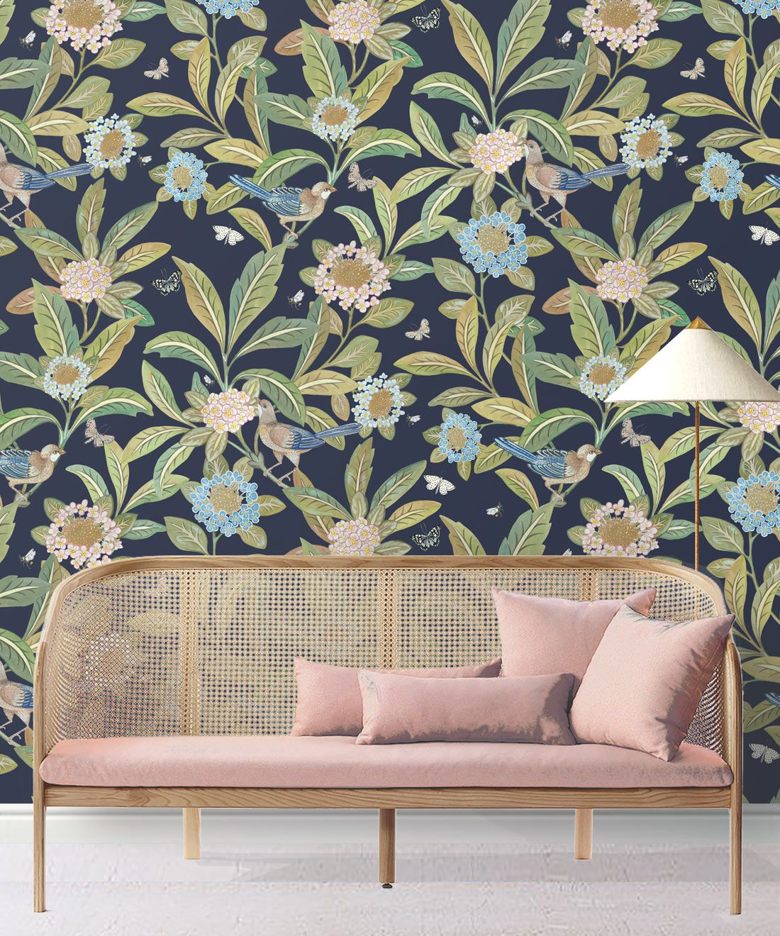Summer Garden Wallpaper • Navy Wallpaper • Floral Wallpaper Insitu behind pink sofa