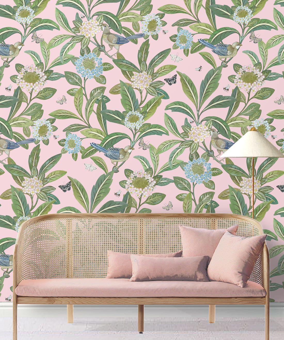 Summer Garden Wallpaper • Pink Wallpaper • Floral Wallpaper insitu behind pink sofa